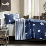 celestial-feel-for-men-bedroom-with-Star-Quilt-Set-in-blue-and-classic-printed-quilt-also-made-of-full-cotton-and-geometric-pattern-and-star-pattern-on-one-side-and-colored-stripes