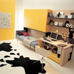 cheerful bedroom ideas with yellow painted wall and compact bed with cabinets and small bedroom desks completed with wall mounted shelves and awesome rug