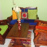 classic vintage wooden chairs idea with carved style and colorful rustic cushions design with wooden coffee table