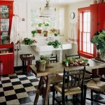 comfortable country red kitchen design idea with indoor plants and plaid black and white flooring idea and wooden dining set and white storage and red framed glass window