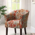 cool accent chairs with orange leaf motif plus wooden leg and comfy back and arms