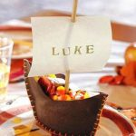 creative-thanksgiving-place-card-with-boat-shaped-placecard-ideas-in-brown-color-with-person's-name-Luke-on-the-plate-near-glass-on-the-wooden-table