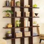 elegant wooden creative shelving idea with plaid design for books and decoration with storage bins aside creamy sofa