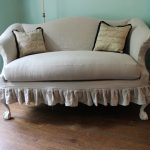 exclusive creamy queen anne couch design with slip cover and sleeve and brown framed cushion on wooden floor aside glass window with blue painted wall