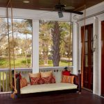 exotic white swing set for porch idea with floral patterned cushopn design above wooden floor of white house with wooden ceiling