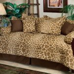 fashionable daybed design idea with leopard pattern and brown cushion and wooden frame and table lamp