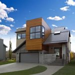 geometrical architecture of modern compact house design with glass facade and gray roof and concrete siding and landscape