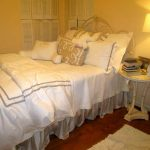 girly restoration hardware linen sheets with white and brown accent plus comfy bed and round night stand or end table plus pretty table lamp and small rug