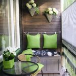 gorgeous apartment balcony furniture with small wooden bench and decorative cushion plus siimple outdoor chairs and round glass top coffee table and cute flowers