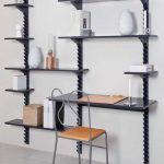 gorgeous black metal creative shelving idea with desk and creamy metal chair with pottery decoration
