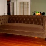 gorgeous brown velvel queen anne couch idea with curved backrest and tuft texture on wooden floor in gray living room