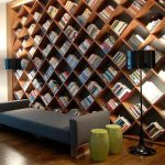 gorgeous diamond shaped wooden wall bookshelves design with black shade floor lamp and wooden floor and gray bench and green ottoman