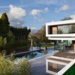 gorgeous eco friendly modern house design with hovering mode and glas siding and pool and garden landscape