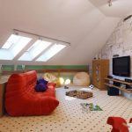 gorgeous orange sofa bed design with playful area rug and tv console and wall texture and skylight in small attic bedroom