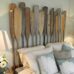 gorgeous paddle shaped cherrry wood headboard idea for vintage bedding with soft blue pillows and stripe table lamps