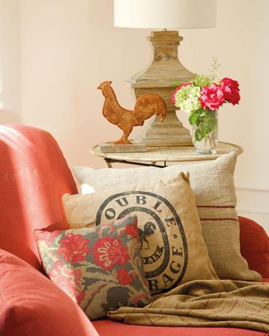 Sofa with Rustic Cushions Showcases Antique Style