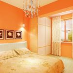 gorgeous sheer orange window treatment ideas for bedroom with orange painted wall with chandelier and white bedding with wall palette