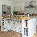 gorgeous vintage wire chairs before breakfast bar design with white cabinetry and wooden top and wooden floor