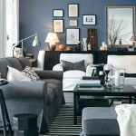 gray living room design with gray sofa and white slipcover and black wooden coffee table and round small end table and wall picture target