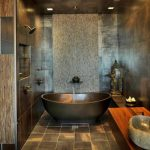 great asian interior style with metallic bathtub and wooden vanity and tile rustic flooring and concrete wall siding and gloomy lighting