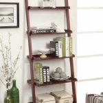 greay burgundy modern ladder bookshelf design with five slots on wooden floor and glass window and pottery decoration