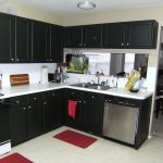 kitchen makeovers on a budget with elegant kitchen cabinets in black and white countertop plus steel sink and faucet