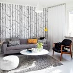 livable scandinavian home design idea with blac arm chair and gray sofa and orange pola dot cushion and white pouff and white round area rug and gray area rug