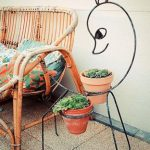 lovable duck shaped wrought iron stand ida for flower with orange pot aside rattan sofa