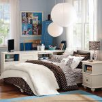 luxurious college dorm room idea with brown white bedding design with small polka dot pattern and white pendants and blue siding paint and white cutrain