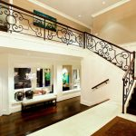 luxurious home design idea with posh foyer deign with bench and wooden floor and glass window and wall mirror