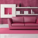 luxurious interior deisgn with pink accent adn pink furniture and white wall racks and pink sofa and rug and pink painted wall