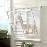 madison-fold-down-wall-mounted-laundry-drying-rack-with-seven-rungs-apiece-and-Classic-beadboard-detailing-with-fresh-white-finish