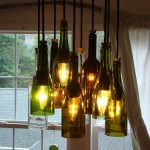 modern recycle wine bottle chandelier idea with black wire suspension in a room with open plan