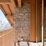 narrow stone balcony design idea with wooden ceiling and wooden fence and wooden small table and wooden window frame