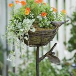 natural bird nest flower stand made of wrought iron idea and dried tree branch and shrub