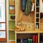 natural wooden coat rack ideas with boots storage idea with small slots on gray tile flooring idea with green painted wall