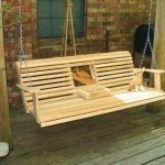 natural wooden porch swing set with small folded coffee table on gray wooden flooring and rustic siding decoration idea