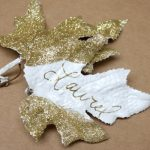 nice-and-simple-place-card-with-gold-sparkle-with-leaves-shaped-and-name's-person-Laurel-on-white-part