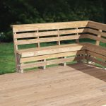 outdoor corner bench made of wooden in light finishing completed with back and wooden floor plus green grass