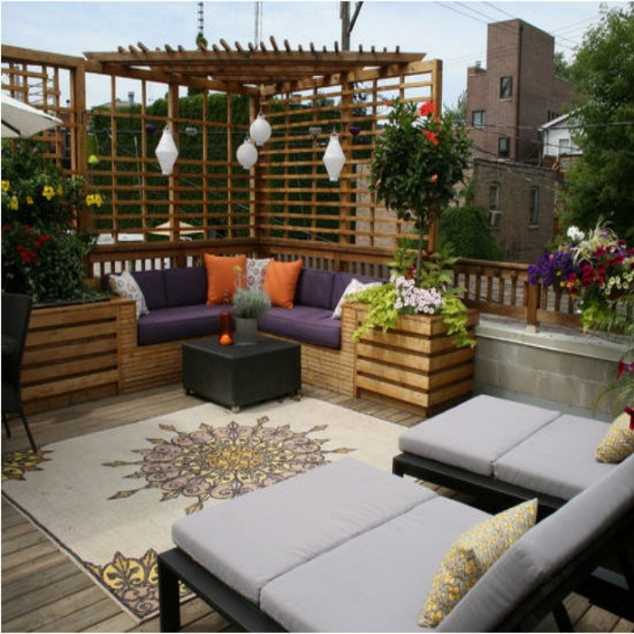 Outdoor Pergola Corner Bench With Purple Upholstery And Lounge Chairs Plus Rug For Balcony