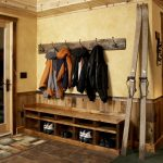 rustic wooden coat rack ideas with wooden shoes and boots storage with yellow painted wall with tile flooring