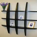 simple-and-cool-decorative-shelving-units-with-dark-wooden-in-unique-plaid-form-for-pictures-or-decorative-stuffs-suitable-furniture-in-ornamental-for-rooms