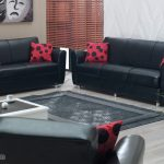simple black leather ikea sofa bed deesign with red patterned cushion and white rectangle coffee table and gray area rug and indoor plant