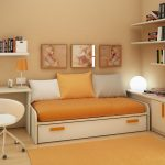 small bedroom desks with modern bed and cabinets plus bookshelves and comfy chairs and orange rug
