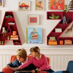 small-children-room-with-floating-red-A-and-Z-letters-for-shelves-to-store-books-notes-and-stuffs-hang-on-the-white-wall-near-kids-drawing-and-pictures
