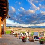 small farm house design with outdoor space with seatings and planter decoration with mountainous view and farm