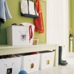 smart-entryway-and-a-family-mudroom-organizer-with-white-metal-storage-bins-for-bags-and-shoes-underneath-bench-and-hooks-for-coats-jackets