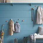 smart-entryway-with-mounted-knobs-at-kids-height-for-their-bags-and-coats-also-other-knobs-at-adult-height-above-the-chair-and-a-floating-shelf-for-decorative-items