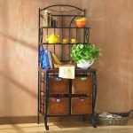 southern-enterprises-iron-bakers-rack-in-black-color-with-four-wicker-storage-drawers-and-two-shelves-for-cookbooks-plates-and-stuffs-also-metal-frame-material-and-laminate-surface-material