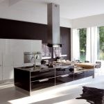 spacious and luxurious italian kitchen design with open plan adn brown island with white cabinetry and relaxing chair in black tone and white flooring idea